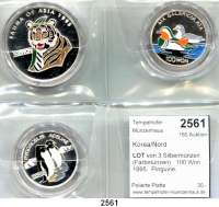 AUSLÄNDISCHE MÜNZEN,Korea/Nord  LOT von 3 Silbermünzen (Farbmünzen).  100 Won 1995.  Pinguine, Mandarinenten und 500 Won 1995.  Tiger.  Schön 93, 94, 102.  KM 70, 104, 69.